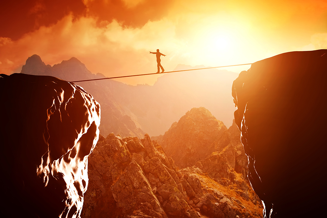 tightrope walker over abyss